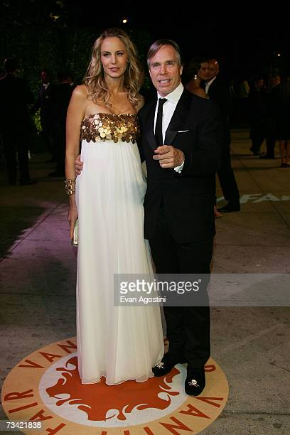 Designer Tommy Hilfiger and wife Susie Hilfiger arrive at the 2007 Vanity Fair Oscar Party at Mortons on February 25 2007 in West Hollywood California