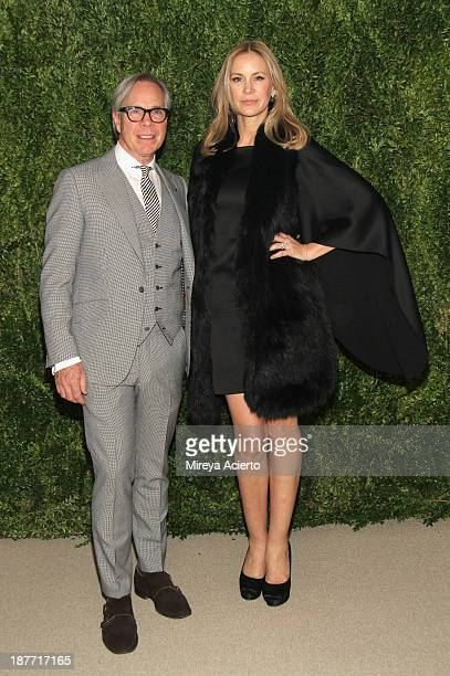 Designer Tommy Hilfiger and Dee Ocleppo attend CFDA and Vogue 2013 Fashion Fund Finalists Celebration at Spring Studios on November 11 2013 in New...