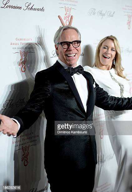 Designer Tommy Hilfiger and Dee Ocleppo attend Gabrielle's Angel Foundation Hosts Angel Ball 2013 at Cipriani Wall Street on October 29 2013 in New...