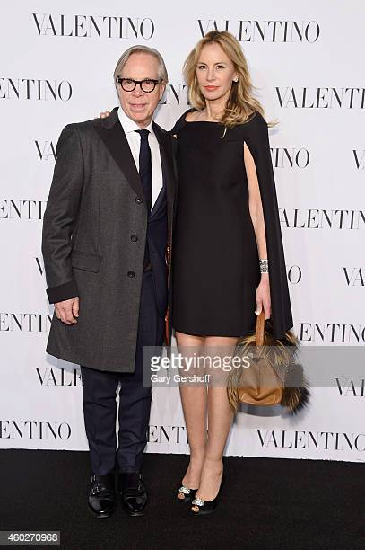 Designer Tommy Hilfiger and Dee Ocleppo attend the Valentino Sala Bianca 945 Event on December 10 2014 in New York City