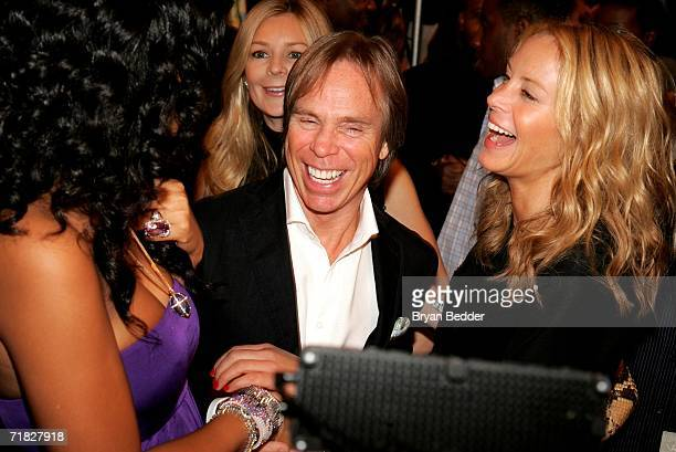 Designer Tommy Hilfiger and Dee Ocleppo greet designer Kimora Lee Simmons backstage at the Baby Phat by Kimora Lee Simmons Spring 2007 fashion show...
