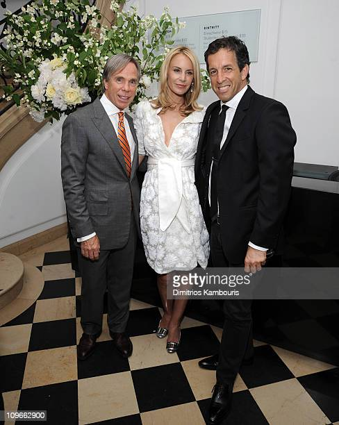 Designer Tommy Hilfiger and Dee Ocleppo with designer Kenneth Cole at their engagement party hosted by Leonard and Evelyn Lauder at Neue Galerie on...