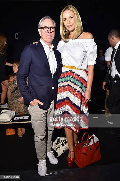 Designer Tommy Hilfiger and model Dee Ocleppo attend the ARTISTIX fashion show during New York Fashion Week The Shows at The Dock Skylight at...