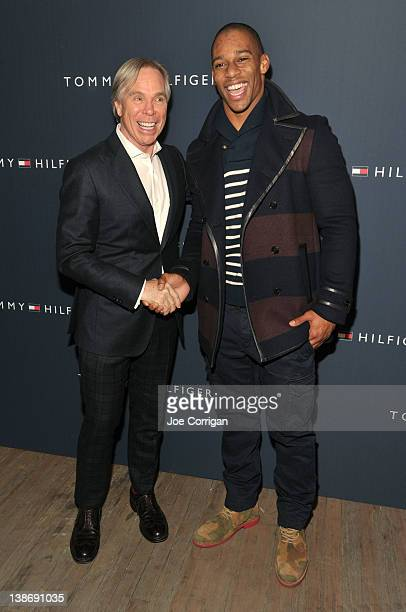 Designer Tommy Hilfiger and New York Giants wide receiver Victor Cruz pose backstage at the Tommy Hilfiger Men's Fall 2012 fashion show during...