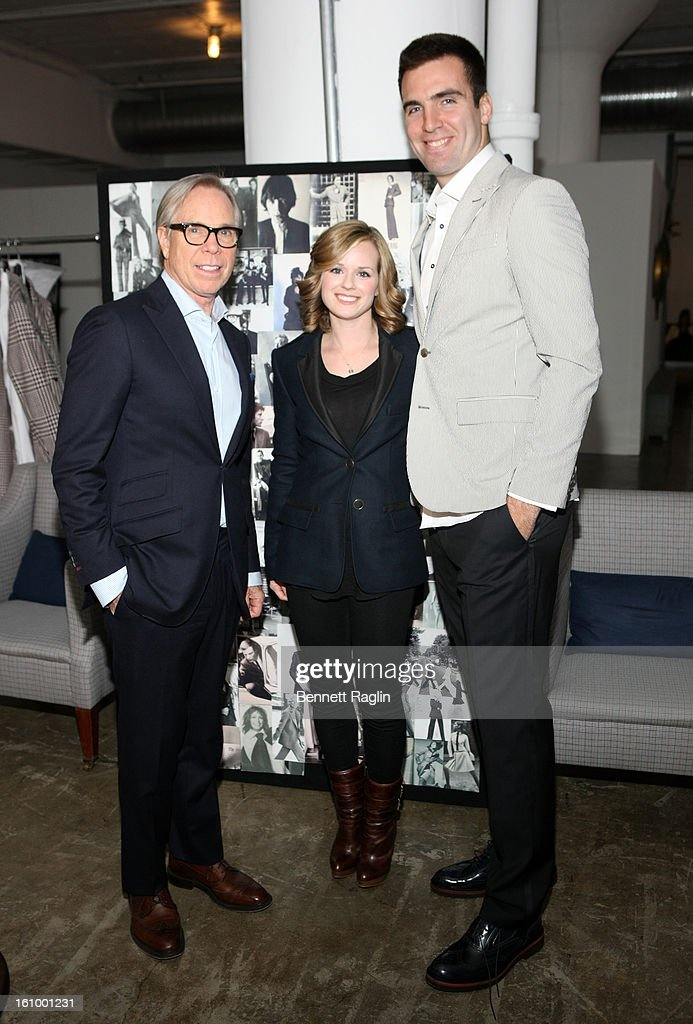 Designer Tommy Hilfiger, Dana Flacco and Joe Flacco pose for a picture during Tommy Hilfiger and Baltimore Ravens Quarterback Joe Flacco get ready for Fashion Week at Hudson Studios on February 7, 2013 in New York City.
