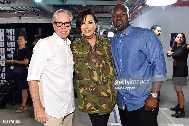 Designer Tommy Hilfiger Kris Jenner and Corey Gamble pose backstage at the #TOMMYNOW Women's Fashion Show during New York Fashion Week at Pier 16 on...