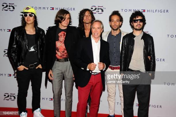 Designer Tommy Hilfiger poses with Julian Casablancas Nikolai Fraiture Nick Valensi Albert Hammond Jr and Fabrizio Moretti of the Strokes attend the...