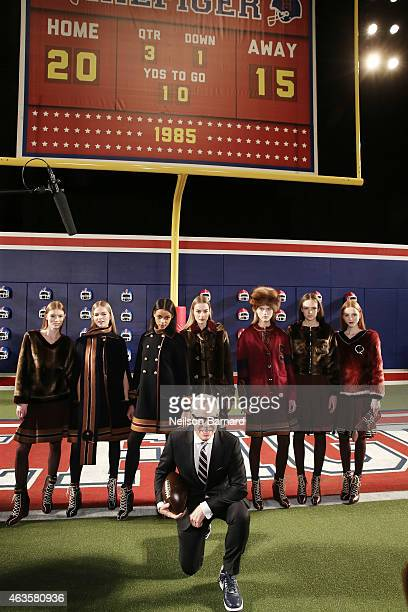 Designer Tommy Hilfiger poses with models at Tommy Hilfiger Presents Fall 2015 Women's Collection during MercedesBenz Fashion Week Fall 2015 at Park...