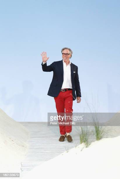 Designer Tommy Hilfiger takes a bow on the runway at the Tommy Hilfiger Women's fashion show during MercedesBenz Fashion Week Spring 2014 at Pier 94...