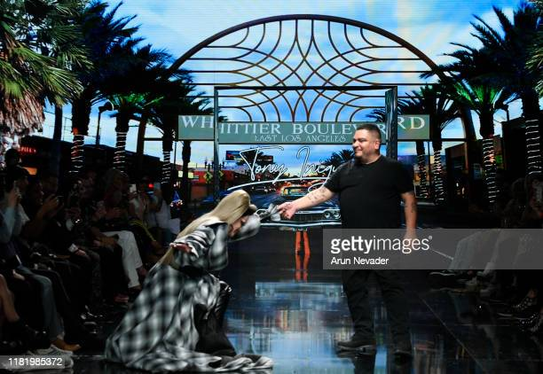 Designer Tony Iniguez walks the runway with Morgan McMichaels during Los Angeles Fashion Week SS/20 Powered by Art Hearts Fashion on October 18 2019...