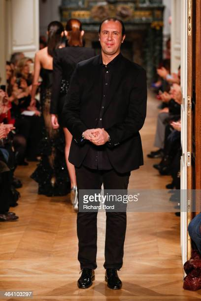 Designer Tony Ward aknowledges the public after his show show as part of Paris Fashion Week Haute Couture Spring/Summer 2014 on January 20, 2014 in...
