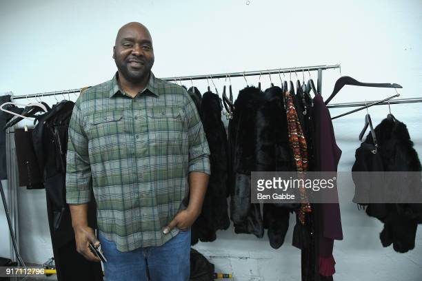 Designer Travis Hamilton poses backstage at the Negris LeBrum fashion show during New York Fashion Week on February 11 2018 in New York City