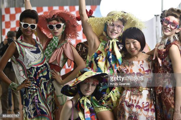 Designer Tsumori Chisato poses with models during the Tsumori Chisato show as part of Paris Fashion Week Womenswear Spring/Summer 2018 on September...