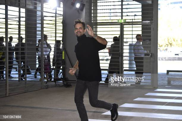 Designer Tuomas Merikoski acknowledges the audience during the Aalto show as part of Paris Fashion Week Womenswear Spring/Summer 2019 on September 26...