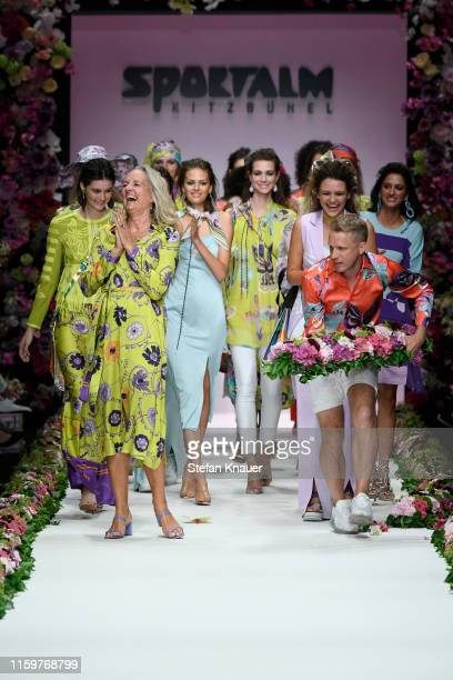 Designer Ulli Ehrlich Oliver Pocher and models acknowledge the applause of the audience after the Sportalm Kitzbuehel show during the Berlin Fashion...