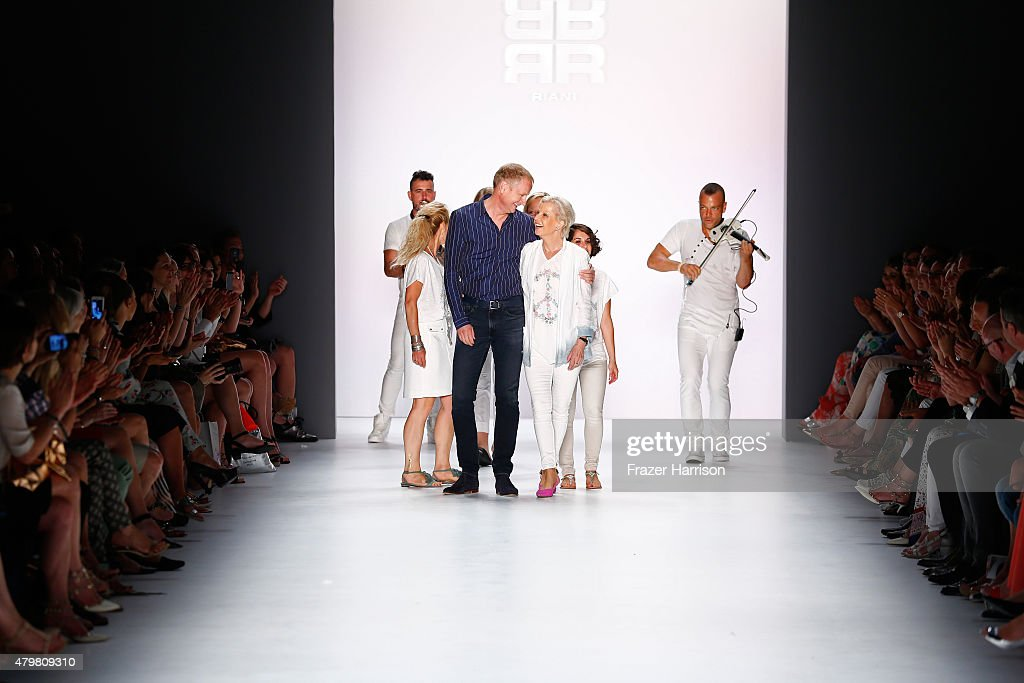 Designer Ulrich Schulte and group the models walk the runway at the Riani show during the Mercedes-Benz Fashion Week Berlin Spring/Summer 2016 at Brandenburg Gate on July 7, 2015 in Berlin, Germany.