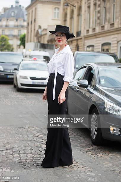 Designer Ulyana Sergeenko wheres a black and white outfit with a hat at the Dior show at 30 Avenue Montaigne on July 4 2016 in Paris France