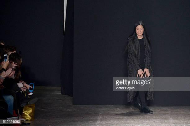06e0606a4db Designer Uma Wang acknowledges the applause of the audience at the runway  at the Uma Wang