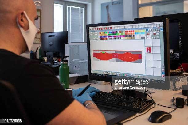 Designer use a CAD software to design a protective face mask at Cifra production plant on March 25, 2020 in Verano Brianza, near Milan, Italy. Cifra...