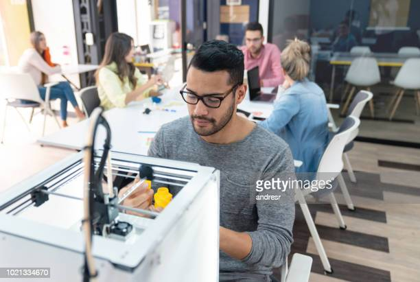 Designer using a 3D printer