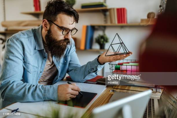 designer using graphics tablet - pyramid shapes around the house stock pictures, royalty-free photos & images