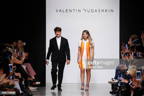 Designer Valentin Yudashkin and his daughter Galina walk the runway during the Valentin Yudashkin Paris show as part of Paris Fashion Week Womenswear...