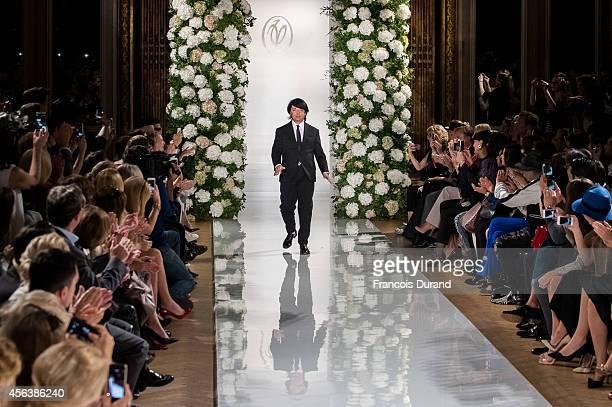 Designer Valentin Yudashkin poses on the runway after the Valentin Yudashkin show as part of the Paris Fashion Week Womenswear Spring/Summer 2015 on...