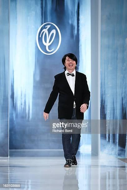 Designer Valentin Yudashkin walks the runway during the Valentin Yudashkin Fall/Winter 2013 Ready-to-Wear show as part of Paris Fashion Week at Hotel...