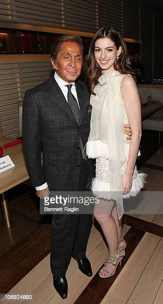 Designer Valentino and Anne Hathaway attend the Love And Other Drugs screening at the Rouge Tomate on November 16 2010 in New York City