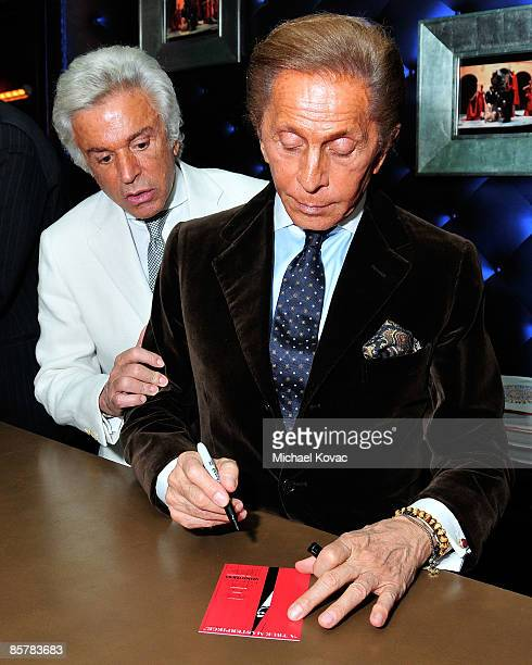 Designer Valentino signs copies of his book 'Valentino A Grand Italian Epic' as Giancarlo Giammetti looks on at Taschen on April 2 2009 in Beverly...
