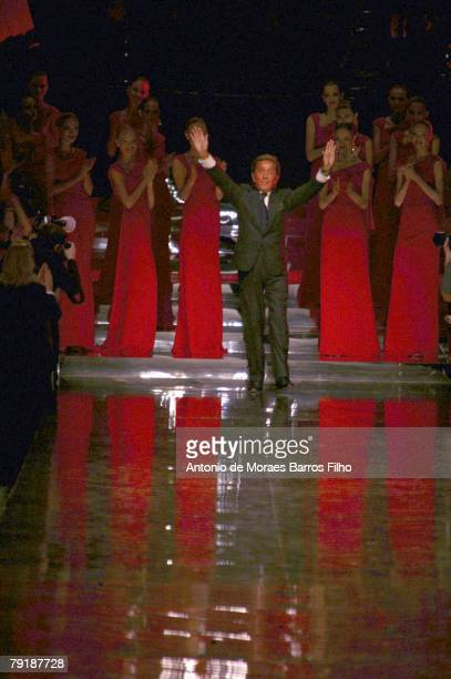 Designer Valentino walks the runway at the end of the Valentino fashion show, part of the Paris Spring/Summer 2008 Haute Couture Fashion Week on...