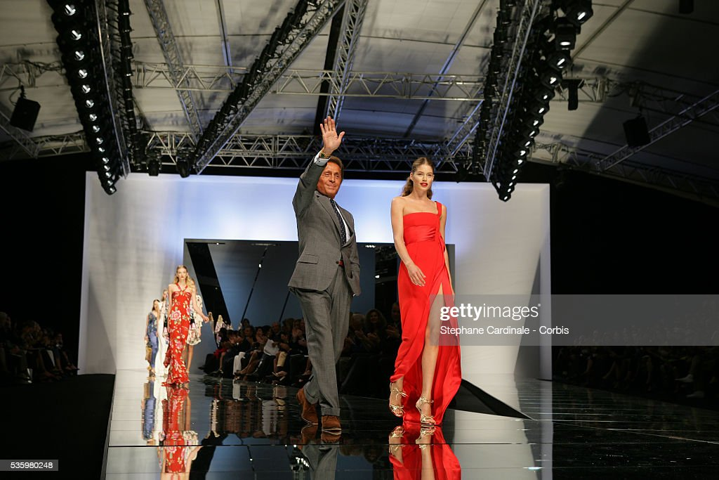 Designer Valentino with his models on the catwalk at the 'Valentino ready-to-wear spring-summer 2006 collection' fashion show.