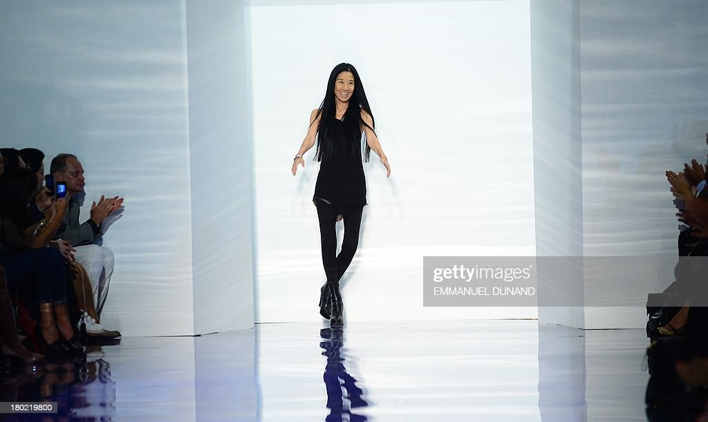Designer Vera Wang greets spectators after her show during the Mercedes-Benz Fashion Week Spring 2014 collection in New York on September 10, 2013. AFP PHOTO/Emmanuel Dunand
