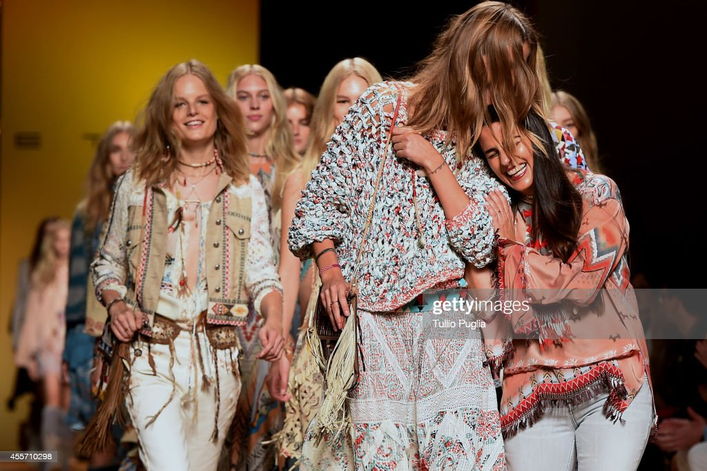 Designer Veronica Etro (R) acknowledges the applause of the public after the Etro show as a part of Milan Fashion Week Womenswear Spring/Summer 2015 on September 19, 2014 in Milan, Italy.