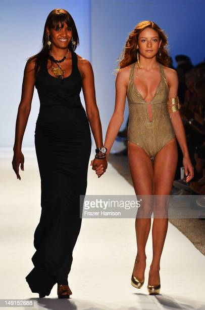Designer Veronique de la Cruz and a model walk the runway at the Aquarella Swimwear show during MercedesBenz Fashion Week Swim 2013 at The Raleigh on...