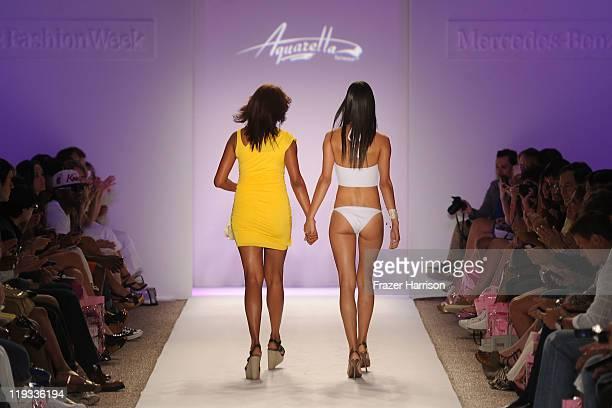 Designer Veronique De La Cruz walks the runway with a model at the Aquarella Swimwear show during MerecedesBenz Fashion Week Swim 2012 on July 18...