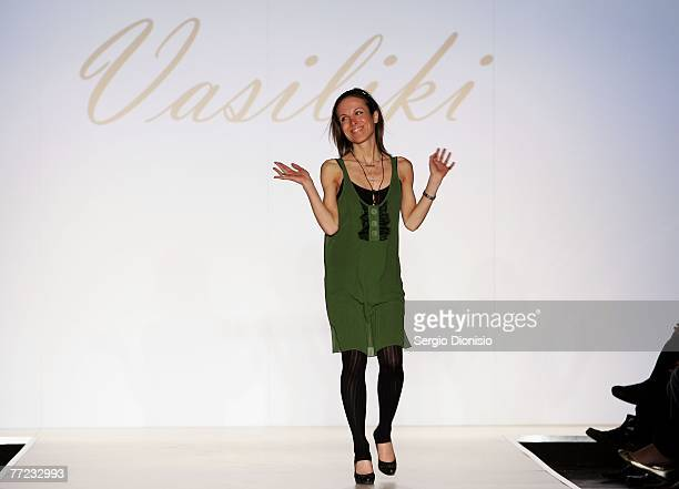 Designer Vicky V Papageorgiou of the label Vasiliki ackonwledges the audience following her catwalk collection show as part of the New Generation...