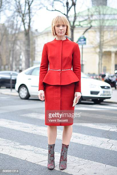 Designer Vika Gazinskaya poses wearing a Vika Gazinskaya coat and Dries Van Noten boots before the Chanel show at the Grand Palais during Haute...
