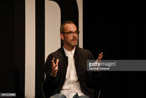 Designer Viktor Horsting speaks at a panel talk ahead of the 'Viktor Rolf' fashion show during Bread Butter by Zalando at Festsaal Kreuzberg on...
