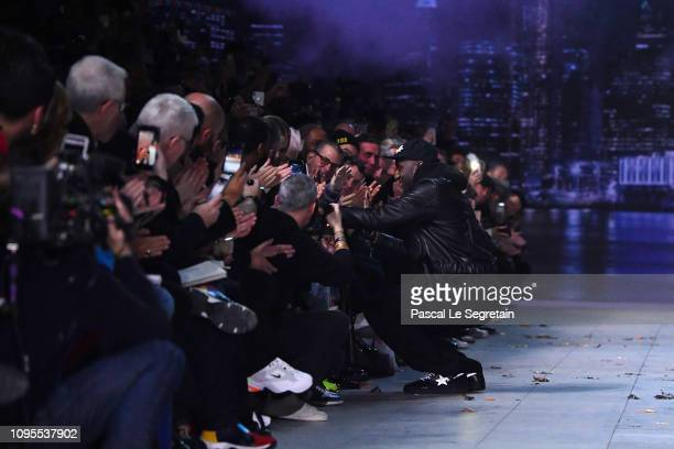 Designer Virgil Abloh greets the crowd during the Louis Vuitton Menswear Fall/Winter 20192020 show as part of Paris Fashion Week on January 17 2019...