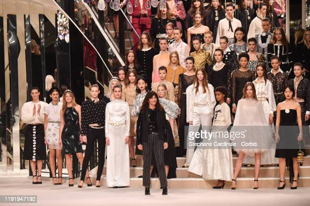 Designer Virginie Viard and Models pose on the runway during the Chanel Metiers d'art 20192020 show at Le Grand Palais on December 04 2019 in Paris...