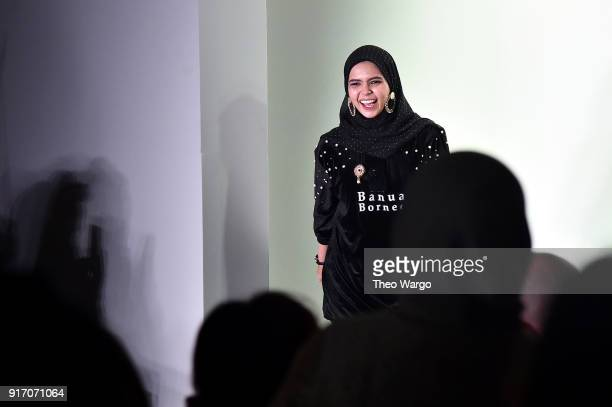 Designer Vivi Zubedi walks the runway in the finale of the Vivi Zubedi show during New York Fashion Week The Shows at Industria Studios on February...