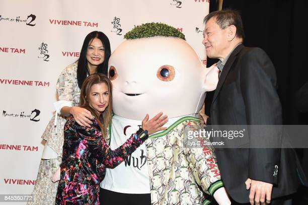 Designer Vivienne Tam actress Alysia Reiner and producer William Kong pose with Wuba backstage for Vivienne Tam fashion show during New York Fashion...