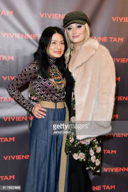 Designer Vivienne Tam and Francesca Curran pose backstage for Vivienne Tam during New York Fashion Week at Spring Studios on February 13 2018 in New...