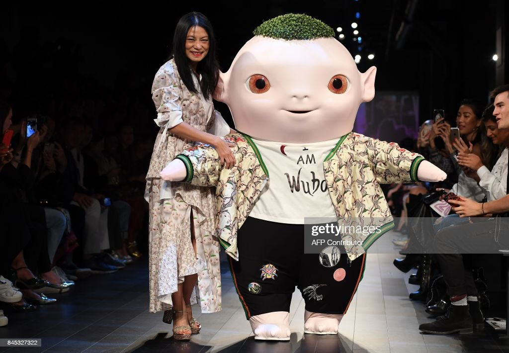 Designer Vivienne Tam and Wuba walk the runway for Vivienne Tam fashion show during New York Fashion Week: The Shows at Gallery 1, at Skylight Clarkson Square on September 10, 2017 in New York City. /