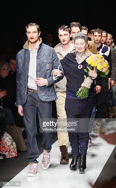Designer Vivienne Westwood akmowledges the applause of the public after the Vivienne Westwood Fashion Show as part of Milan Fashion Week Menswear A/W...