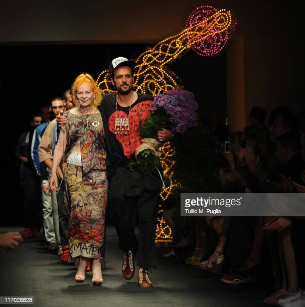 Designer Vivienne Westwood aknowledges the applause of the public after the Vivienne Westwood fashion show as part of Milan Fashion Week Menswear...