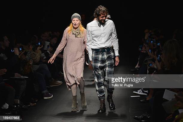Designer Vivienne Westwood and Andreas Kronthaler acknowledge the audience at the end of the Vivienne Westwood show as part of Milan Fashion Week...