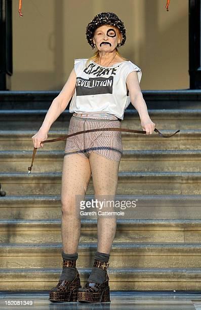 Designer Vivienne Westwood walks on the catwalk by Vivienne Westwood Red Label on day 3 of London Fashion Week Spring/Summer 2013 at the British...