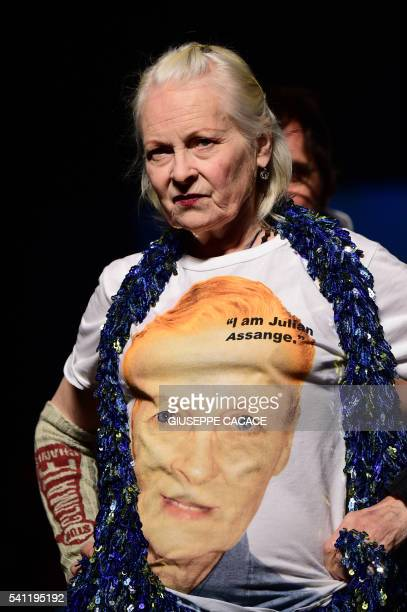 TOPSHOT Designer Vivienne Westwood wears a teeshirt reading 'I am Julian Assange' as she walks the runway at the end of her show during the Men's...